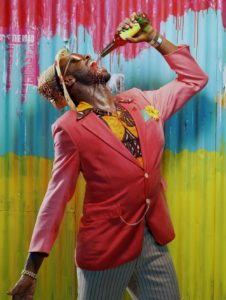 The poster for They Drink It in the Congo, featuring actor Sule Rimi. Photo by Miles Aldridge