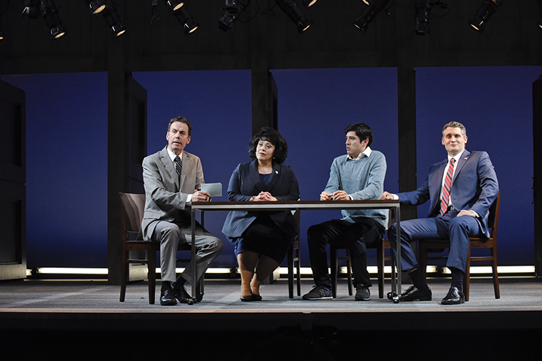 "Chamblee Ferguson, Christie Vela, Ivan Jasso, and Michael Brusasco in ""Deferred Aciton."" Photo by Karen Almond."