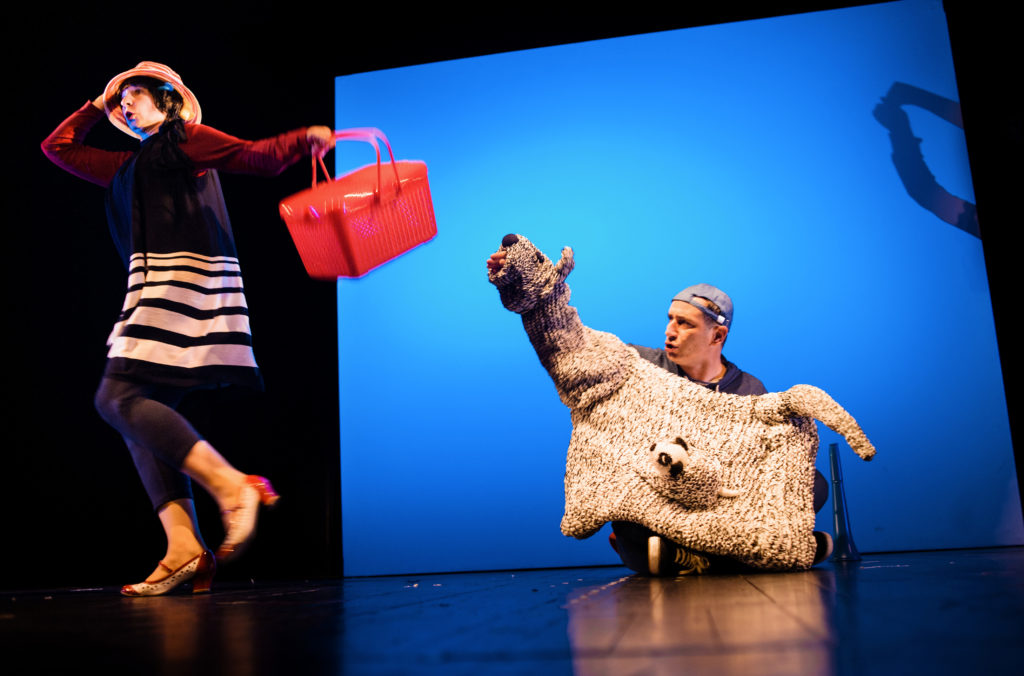 """Daszeńka, czyli żywot szczeniaka"" [""Dashenka, or the Life of a Puppy""], dir. by Jakub Krofta; Teatr Lalka in Warsaw, at the front: Aneta Harasimczuk (Mother/Lady with a Basket); at the back: Mother Dog Iris, Puppy Daszeńka, and Piotr Tworek (Son). Photograph by Bartek Warzecha."