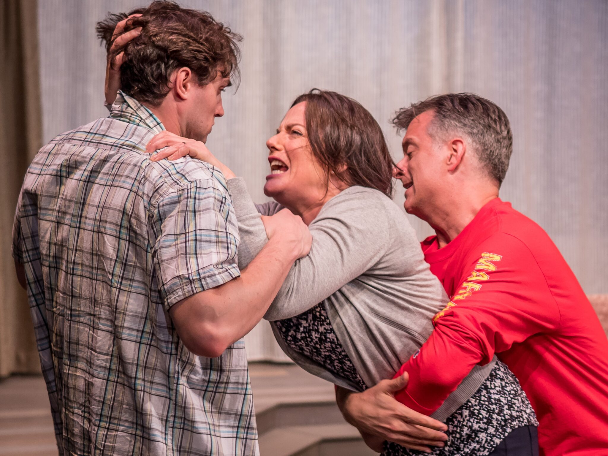 "Robby Haltiwanger as Mike, Danielle Skraastad as Maryanne, and Michael Frederic as James in the Premiere Stages production of ""Linger"" by Craig Garcia 