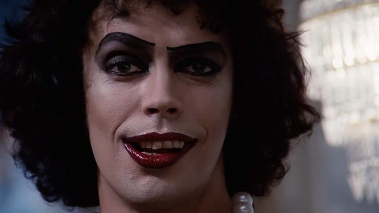 "Violent Clowns And Panto Dames: The Origins Of ""Rocky Horror's"" Frank-N-Furter"