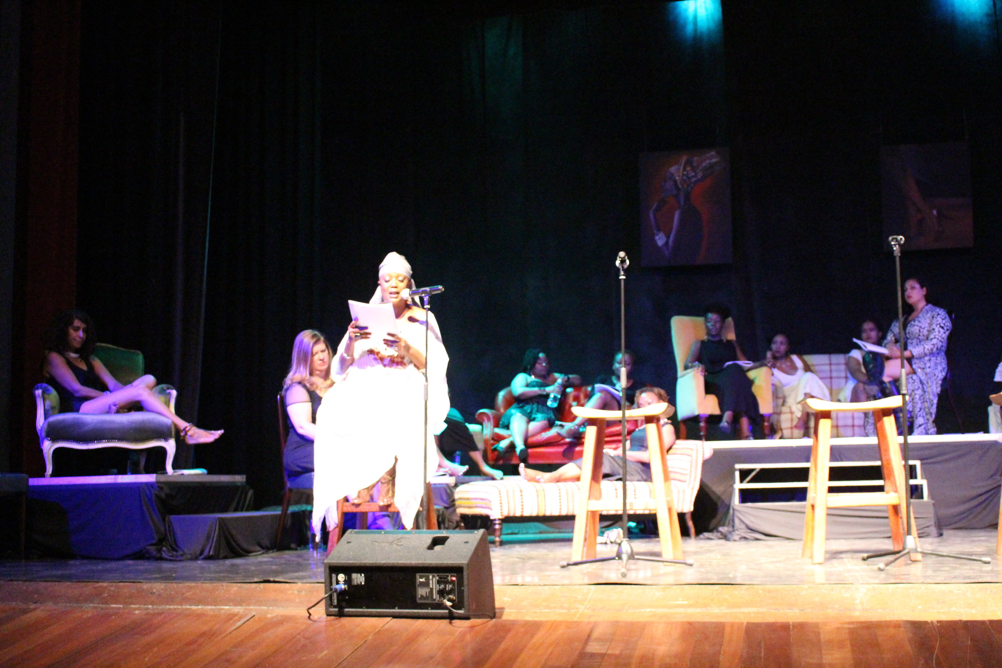 Mŭmbi Kaigwa (in white) during a past production of The Vagina Monologues