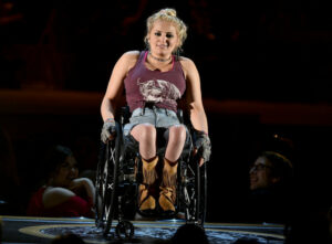 "Ali Stroker performs a song from Rodgers & Hammerstein's ""Oklahoma!"" onstage during the 2019 Tony Awards at Radio City Music Hall on June 9, 2019 in New York City. Photo by Theo Wargo/Getty Images for Tony Awards Productions"