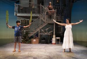 "Medea (Sabina Zúñiga Varela) and her son Acan (Benjamin Luis McCracken) practice a ritual while Tita (Socorro Santiago) looks on in the production ""Mojada"""