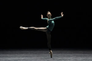 "A single dancer in a promotional image from ""rEVOLUTION"" at Boston Ballet"