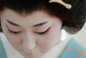 A geisha looking downward.