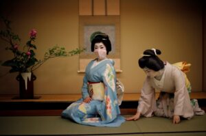 A photo of geisha women