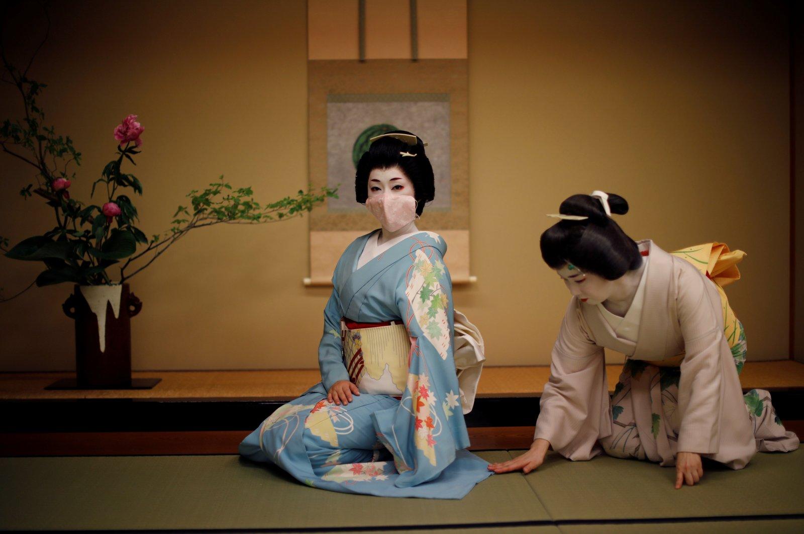 A photo of geisha women