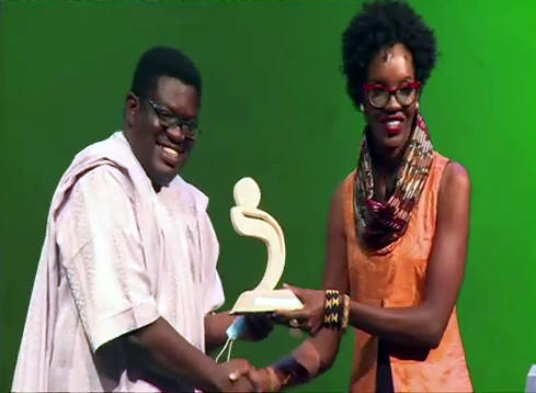 Sanaa Awards CEO George Orido presents a trophy