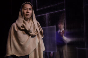 "Jennifer Wang as Len & Mariam Albishah as Ru in ""The Book of Magdalene."" Photo by RicOrnelProductions."