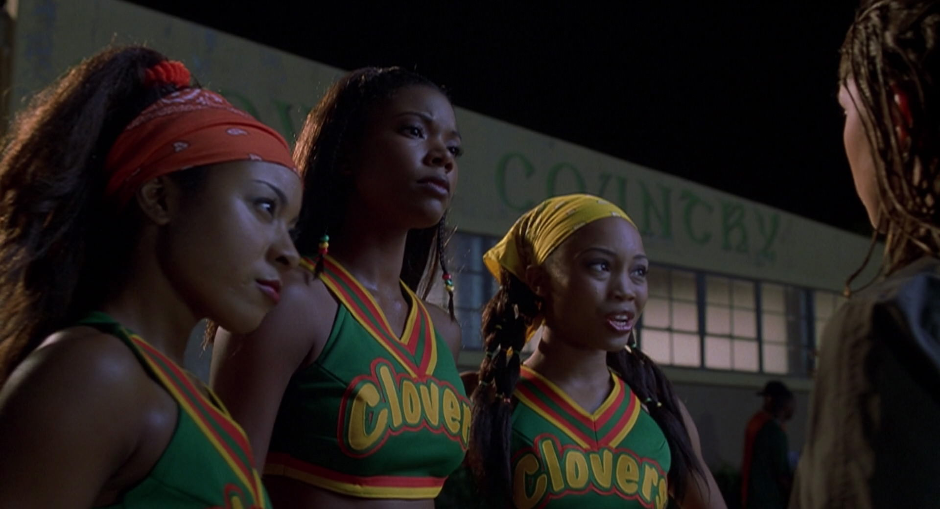 "Members of the Compton Clovers cheer squad confront the Rancho Carne Toros about stealing their dance moves in a now iconic scene from ""Bring It On."""