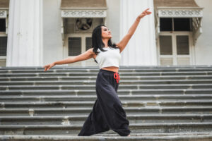 Young woman dancing on steps