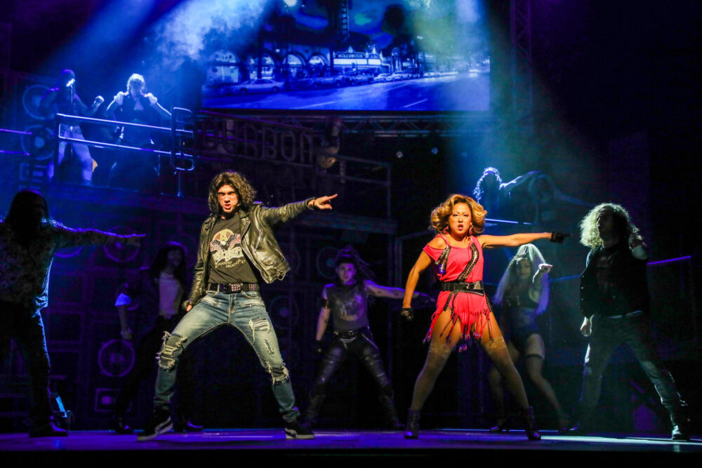 """Justin Matthew Sargent as """"Drew"""" and Diana Huey as """"Sherrie"""" in the new TUTS production of Rock of Ages. Photo by Melissa Taylor."""